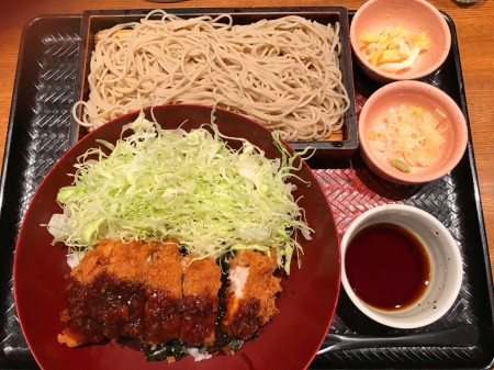 Bowl of rice topped with miso sauce pork cutlet and Shredded cabbage ,soba, japanese pickles at ootoya