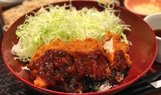 Bowl of rice topped with miso sauce pork cutlet and Shredded cabbage at ootoya