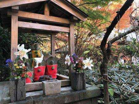 Autumn leaves and Jizo statue in Meigetsuin in Kamakura