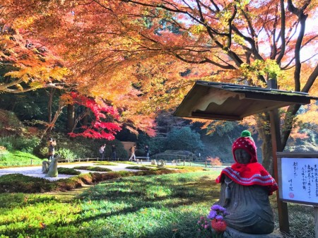 Autumn leaves and Jizo statue at inner garden in Meigetsuin in Kamakura